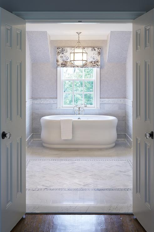Tub Nook with Marble Wainscoting - Traditional - Bathroom