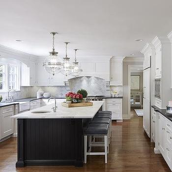 White Kitchen Black Island black oval kitchen island with honed white marble countertops