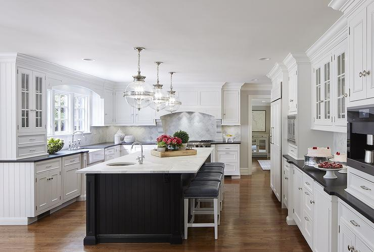 White Kitchen With Black Beadboard Island Transitional