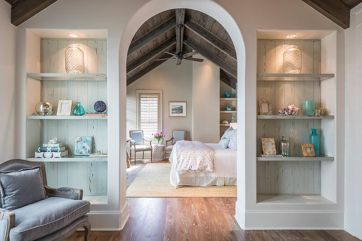 Arched Bedroom Doorway flanked by Built In Bookcases - Cottage - Bedroom