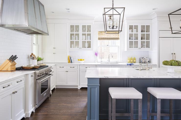 Chic Kitchen Features White Cabinets Painted Benjamin Moore Dove Paired With Calacatta Gold Extra Marble Countertops And A Subway Tiles