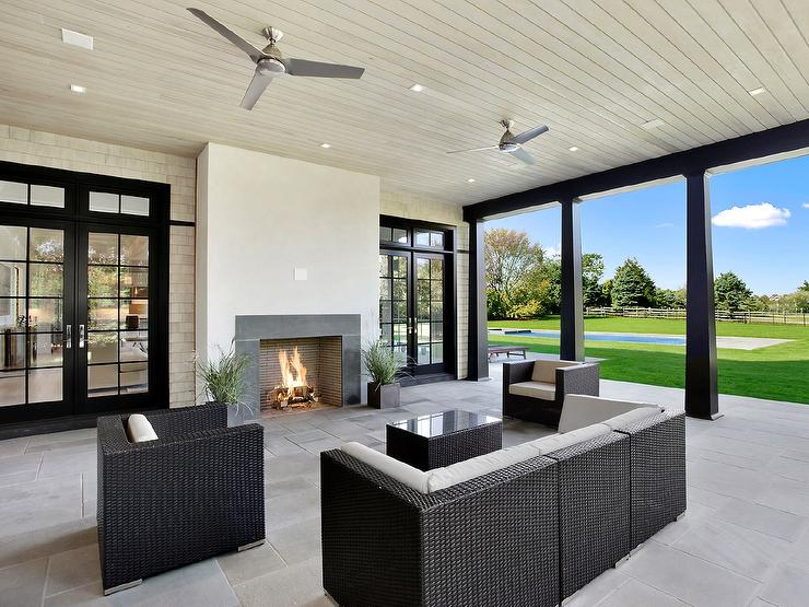 Covered Patio With Gray Modern Outdoor Fireplace