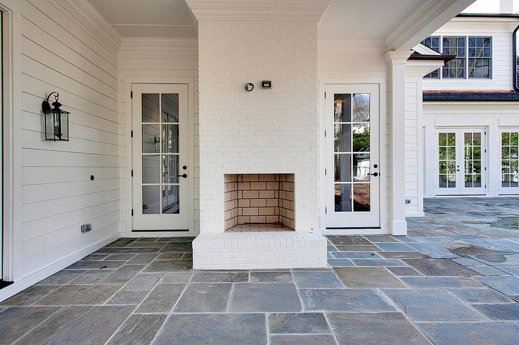 Covered Patio With White Brick Fireplace Transitional