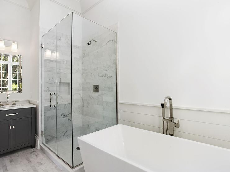 Bathroom With White Beveled Subway Tiles Transitional