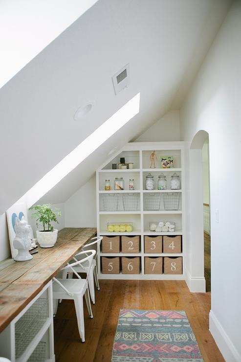 Superior Craft Room With Sloped Ceiling And Skylights