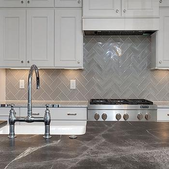 lovely kitchen features a center island topped with soapstone fitted