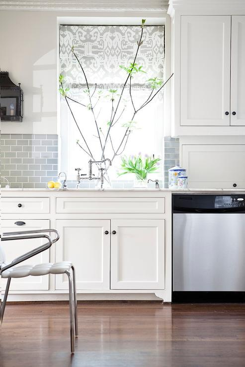 white kitchen with half tiled gray subway tile backsplash