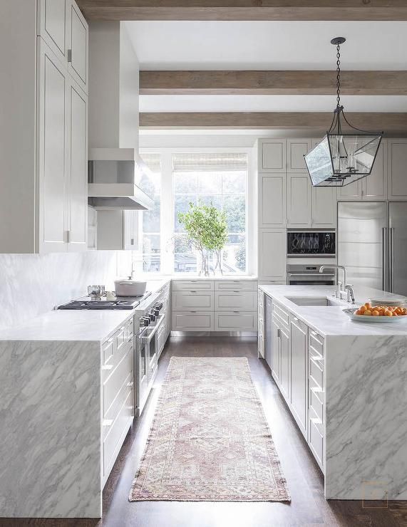 White Kitchen with Grey and White Quartzite Waterfall Edge Countertops
