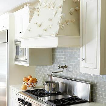 marble countertops and ivory wood paneled backsplash design galleria
