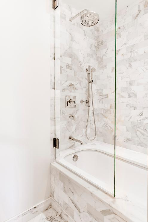 Marble Subway Tiled Tub With Glass Shower Partition Transitional Bathroom