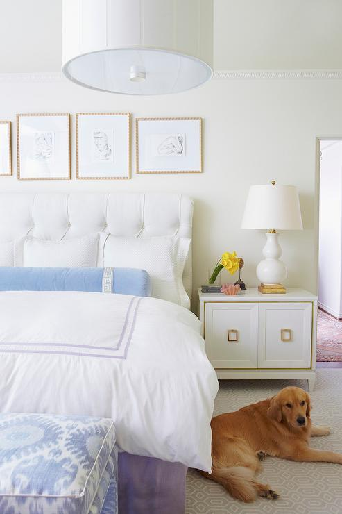 white bedroom with blue and purple accents transitional