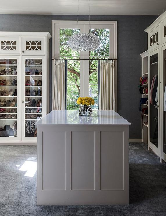 White and grey closet with island contemporary closet for Closet island with glass top