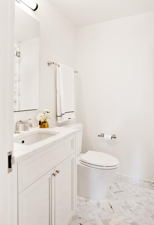 Superbe White Bathroom With Marble Herringbone Floor Tiles