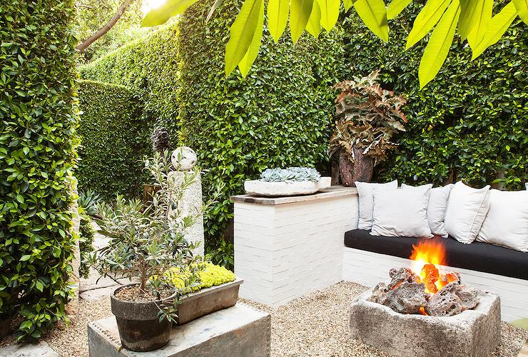 Garden With Built In Sofa And Rustic Firepit