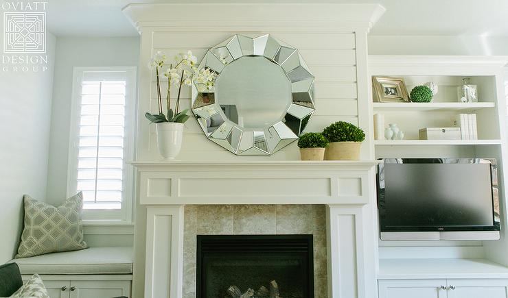 Lovely Living Room Features Boasts A White Fireplace Mantle Under A Round  Mirror Flanked By A Window Seat To The Left And A Media Center As Well As  An ...