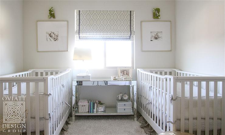 Cribs Facing Each Other With Mirrored Console Table