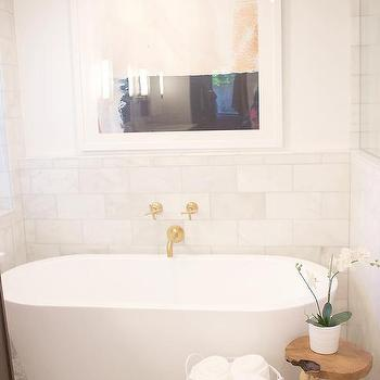 Spa Like Bathroom With Oval Tub And Wall Mount Gold Tub Filler