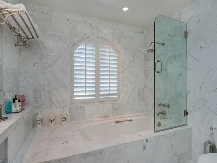 Marvelous Glass Shower Partition #14: Marble Clad Tub With Curved Glass Shower Partition