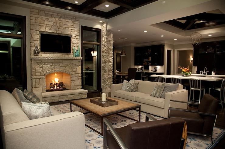 Stone fireplace wall with flatscreen tv niche transitional living room How to design a living room with a fireplace