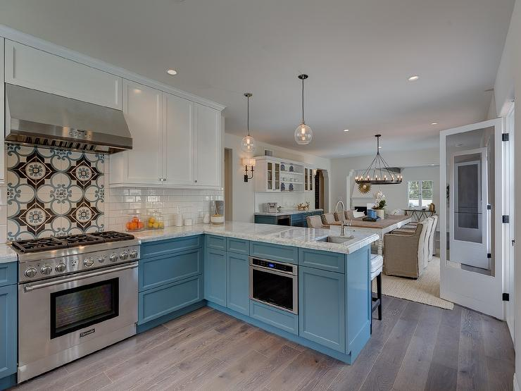 kitchen cabinets dark bottom white top white top cabinets and blue bottom cabinets transitional 20250