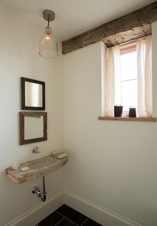 Rustic Powder Room with Concrete Wall Mount Sink and Stacked Mirrors ...