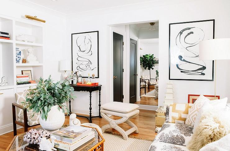 Pencil paper chic living room features black and white print sofa adorned with a gold chain link throw blanket by jonathan adler as well as beige