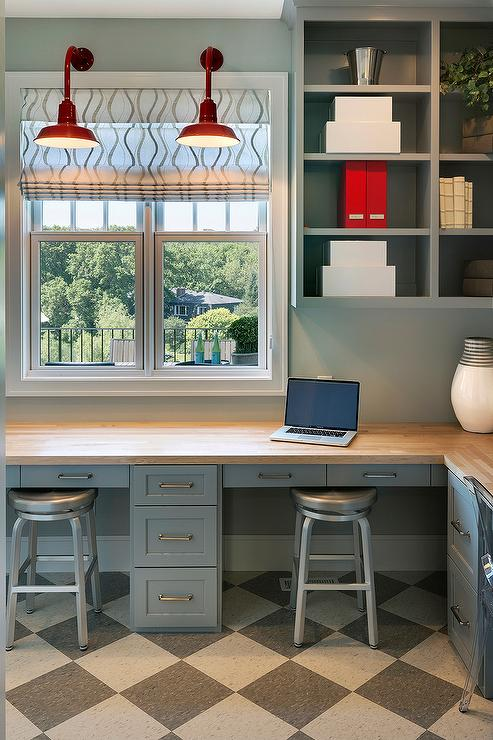 L Shaped Desk Under Windows With White And Gray Stripe