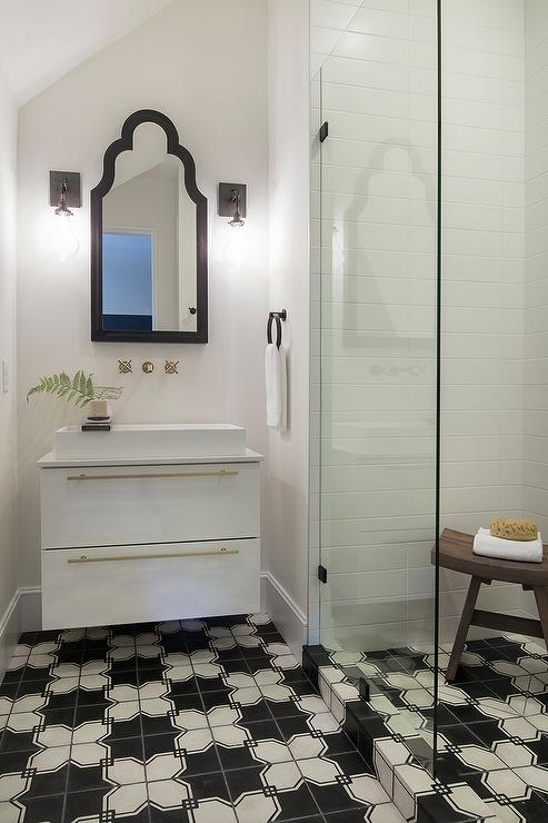 Small Bathroom With Black And White Geometric Tile Floors
