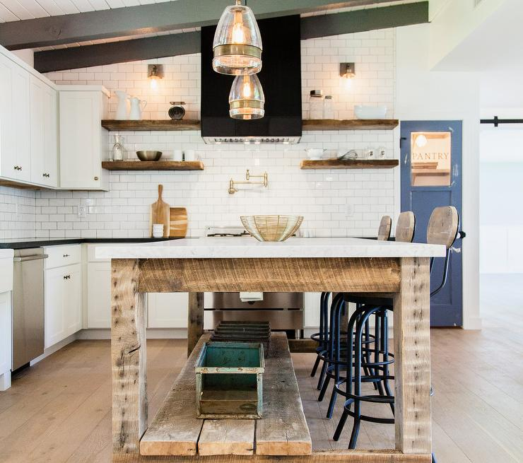 Country Kitchen Features A White Plank Sloped Ceiling Lined With Gray Wood  Beams Over A Reclaimed Wood Freestanding Island Topped With White Marble  Lined ...