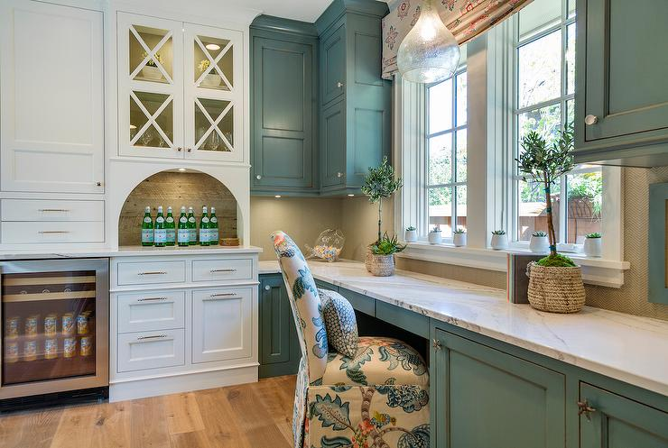 Blue Butler Pantry Cabinets With White Marble Countertops