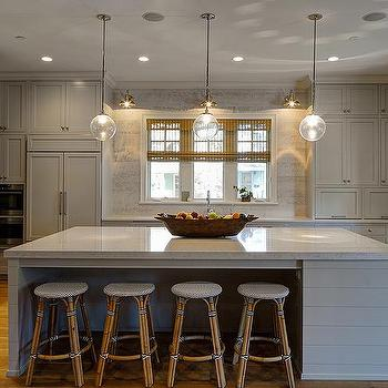gray shiplap kitchen island with backless french bistro stools