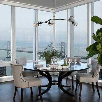 Round Black Dining Table With Gray Linen Chairs