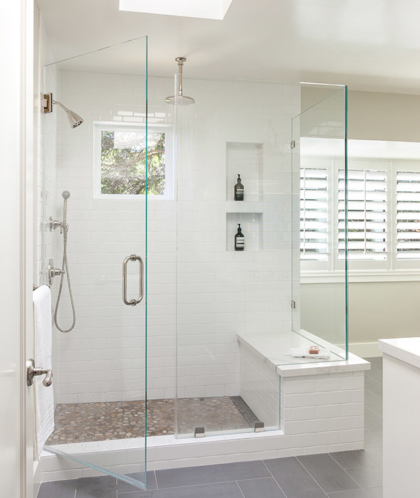 Modern Bathroom Features A Walk In Shower Clad In A Pebbled Floor  Illuminated By A Skylight.