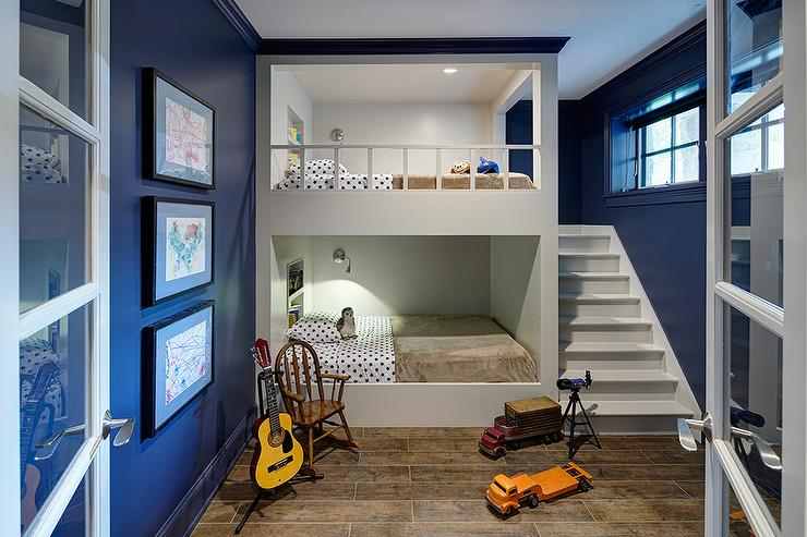 White And Navy Bunk Room With Built In Staircase Contemporary