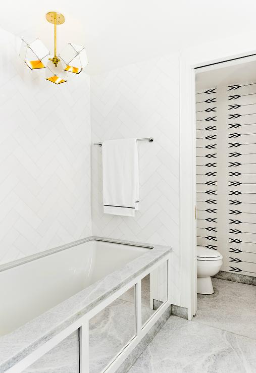 White Herringbone Bathroom Wall Tiles With Antiqued Mirrored Tub