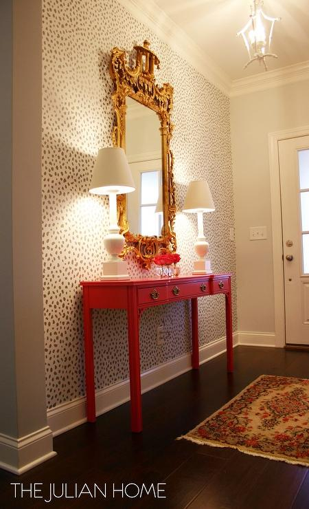 Stenciled foyer wall with hot pink console table for Entry wall table