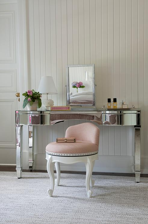 mirrored vanity with pink stool transitional bedroom
