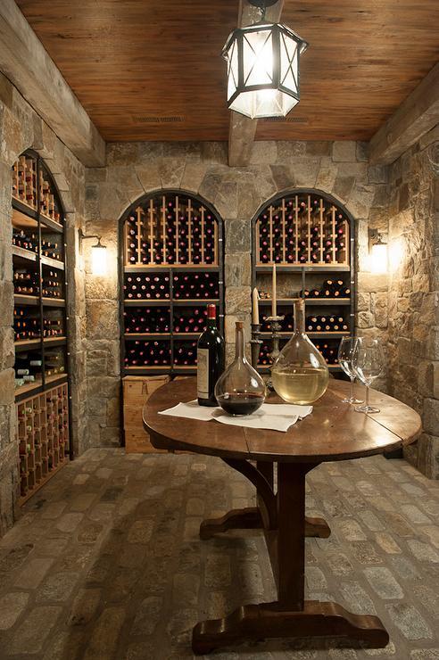 basement wine cellar with arched wine racks mediterranean basement