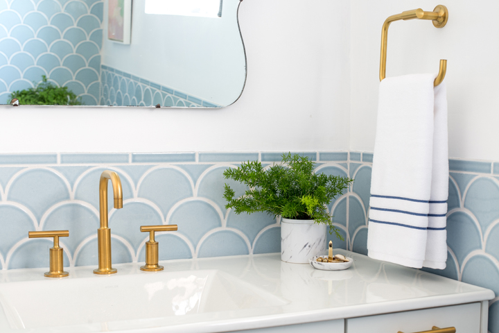 Gold and blue bathroom with fish scale tiles for Blue and gold bathroom accessories