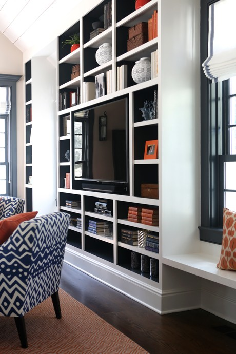 Blue And Orange Living Room Features A Floor To Ceiling Built In Media Unit With Backs Of Shelves Painted Filled Flatscreen TV