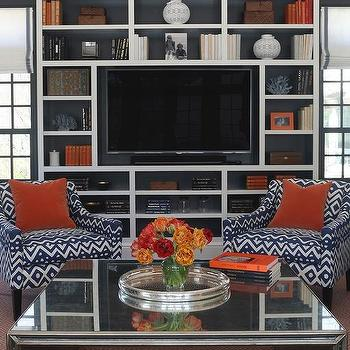 Blue And Orange Living Room With Built In Media Unit