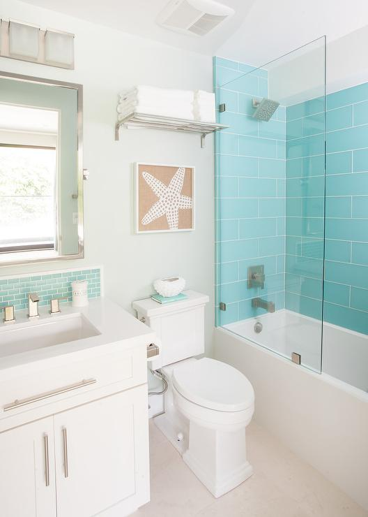 Turquoise glass shower tiles with glass partition for Beach inspired bathroom designs