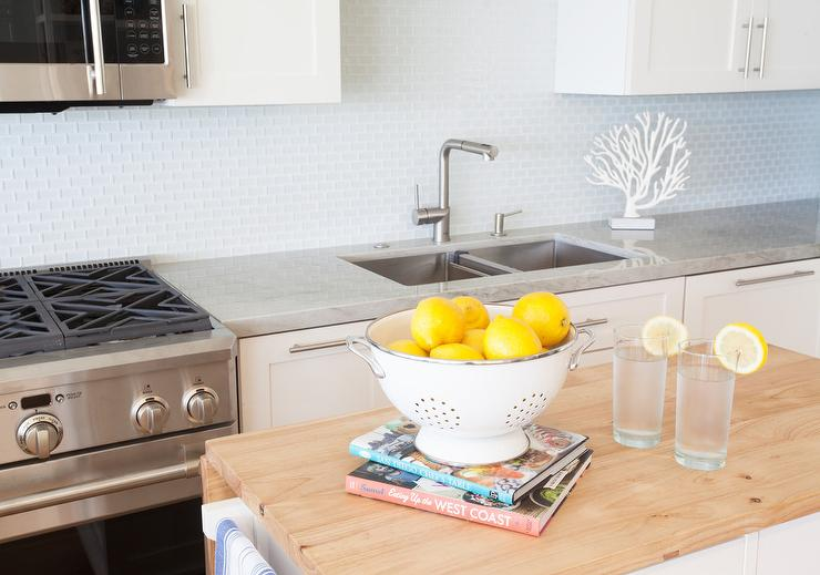 white kitchen cabinets with white glass tile backsplash transitional