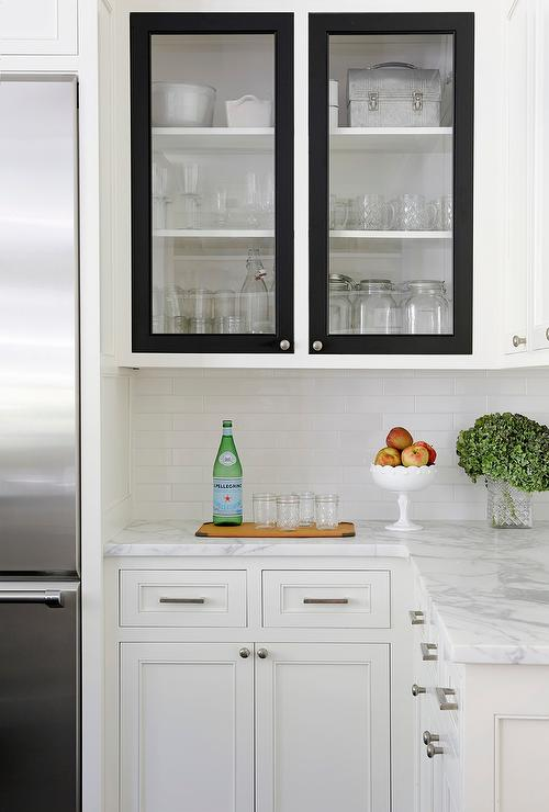 white kitchen cabinets with black doors transitional