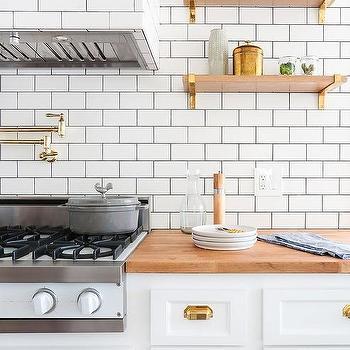 wood kitchen shelves with brass brackets