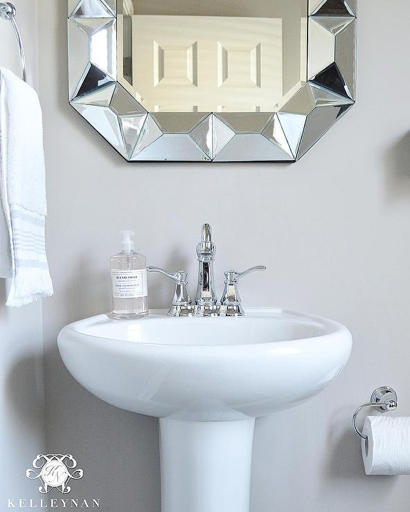 Powder Room Pedestal Sink With Geometric Mirror Transitional