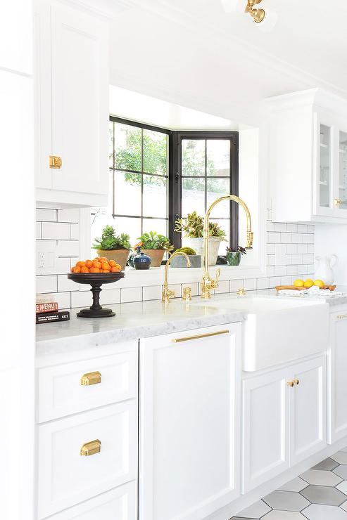 White Kitchen with Gold Gooseneck Faucet