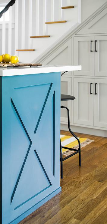 Blue And Gray Kitchen Features A Blue Kitchen Island Topped With White  Quartz Lined With Black Industrial Swivel Stools Alongside A Yellow Striped  Runner.