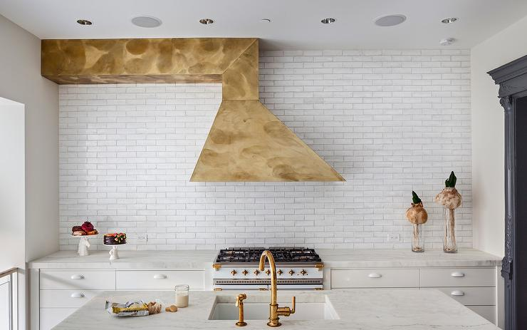 Gold Asymmetrical Kitchen Hood With White French Stove