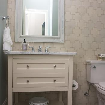cream bathroom with cream cross tiles